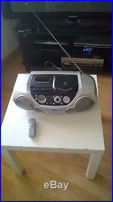Portable Phillips CD player/ CD writer, tape deck. FM/MWithLW. Remote control. AZ2045