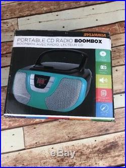 Sylvania Portable CD Player Boom Box with AM/FM Radio Teal Blue iPhone Ipod Jack